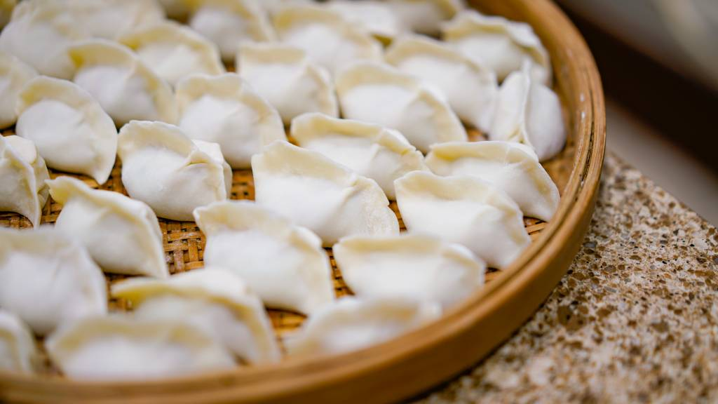 tray of dumplings waiting to be cooked
