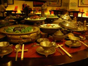 Lavish foods laid out for ancestors during rituals and festivals
