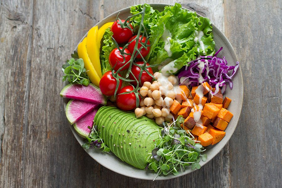 Fresh vegetables in a salad with light dressing is a great light meal to help you stay cool and beat the heat during warmer months