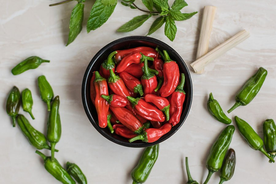 A bowl of red chilli peppers. Chilli peppers are considered a pungent food which can help expel excess heat in the body.